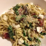 Linguine with creamy pesto, caramelised red onion and spinach