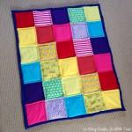 Rainbow patchwork baby quilt