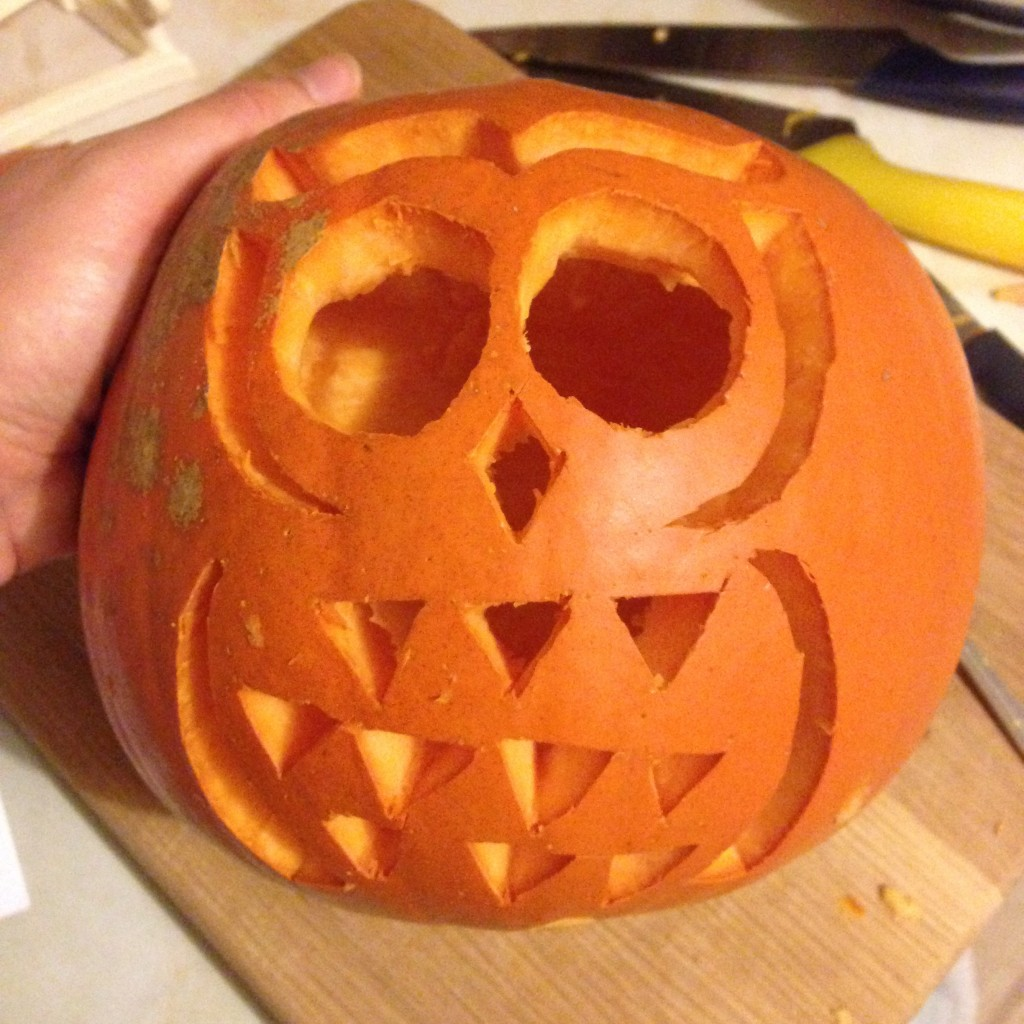 Carving the owl pumpkin