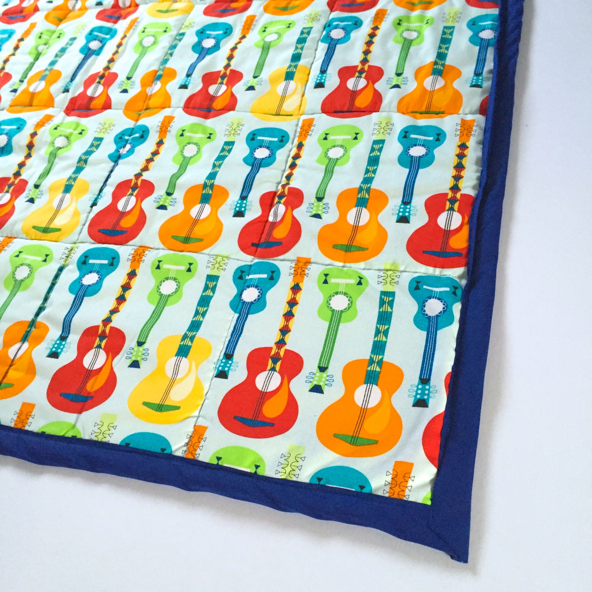Guitar quilt backing