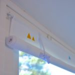Geometric painted roll-up blinds