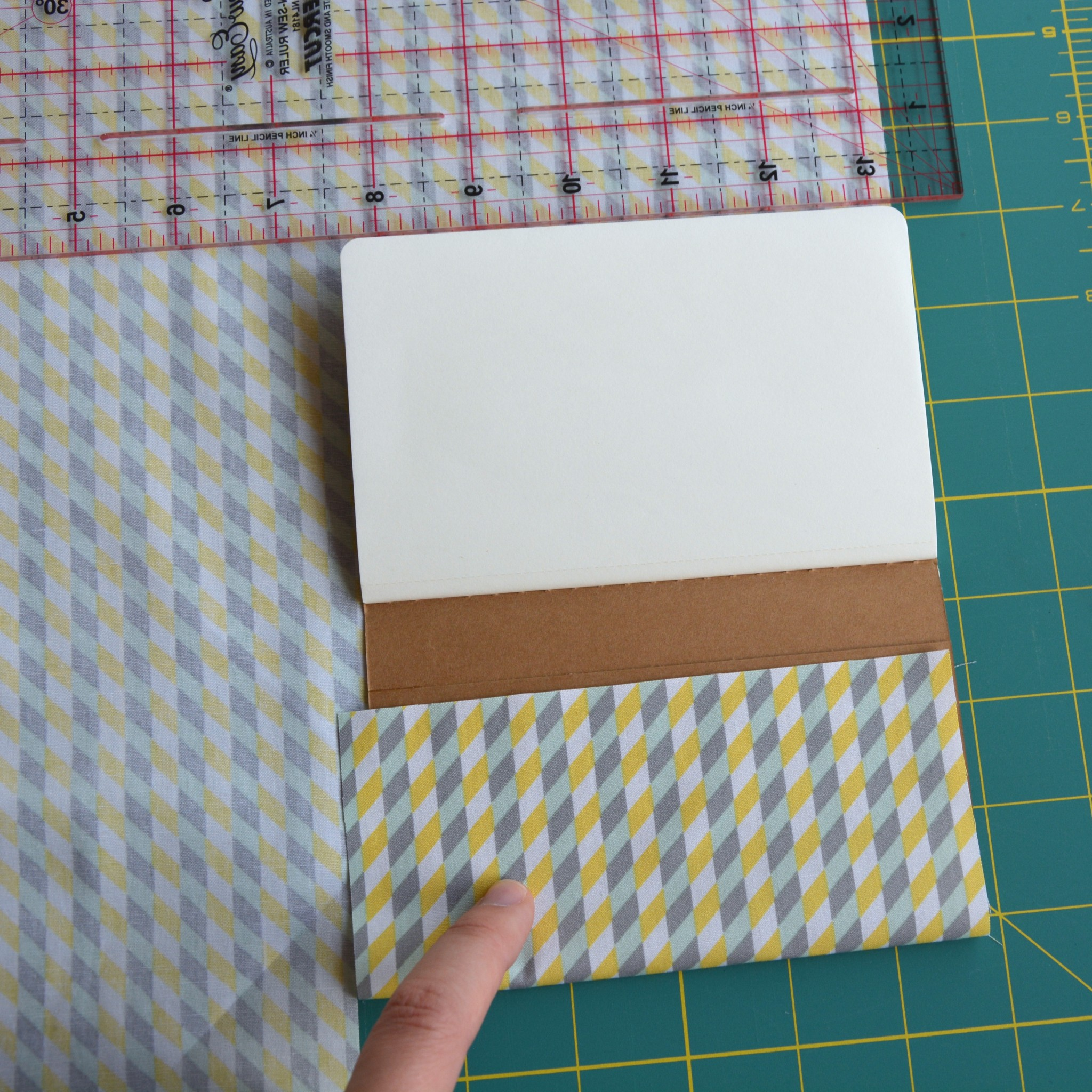 Measuring the fabric for the notebook
