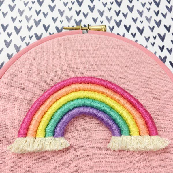 Bright pastel rope rainbow hoop on pink   Hello! Hooray!