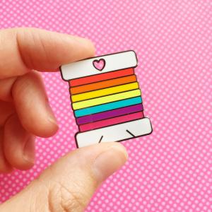 Rainbow bobbin hard enamel pin