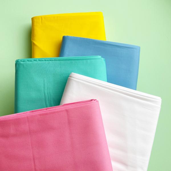 Pure Solids brights fabric bundle stack | Hello! Hooray!